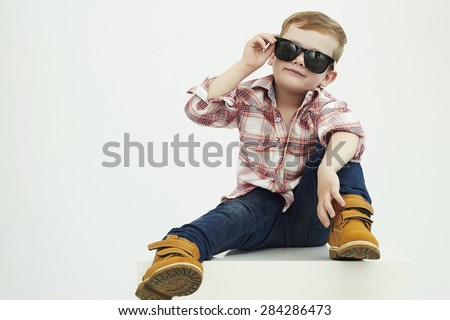 Funny child.fashionable little boy in sunglasses.stylish kid in yellow shoes. fashion children - stock photo