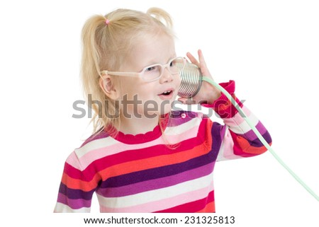 Funny child in eyeglasses using a can as a telephone isolated on white - stock photo