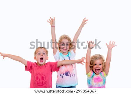 funny children jubilating in front of white background - stock photo