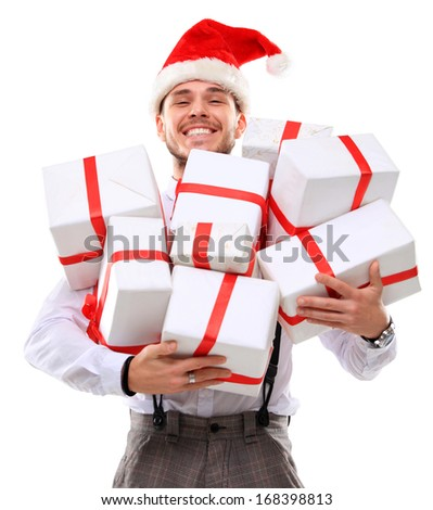 funny christmas man holding many gift boxes over white background ...