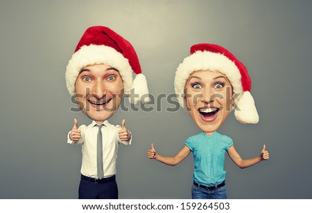 funny christmas picture of happy bighead couple over grey background - stock photo