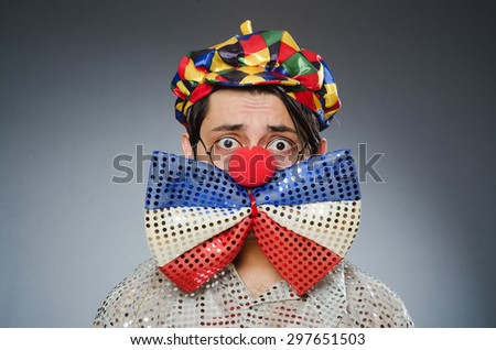 Funny clown against dark background - stock photo