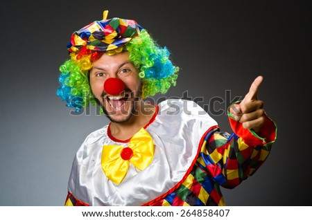 Funny clown in colourful costume - stock photo