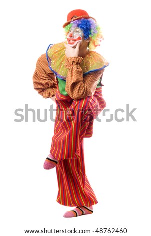 Funny clown standing on one leg. Isolated - stock photo