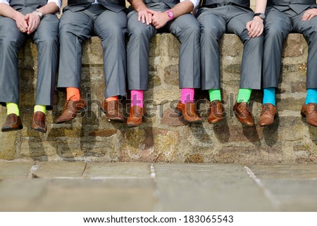 Funny colorful socks of groomsmen - stock photo