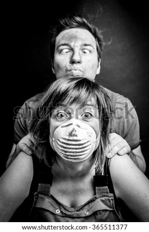 Funny couple with mouth masks on - stock photo