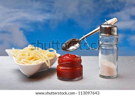 funny cutlery salt shaker cooked italian spaghetti - stock photo