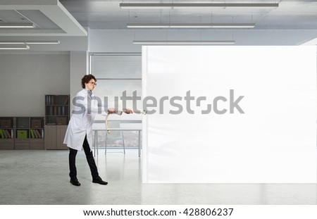 Funny doctor with billboard - stock photo