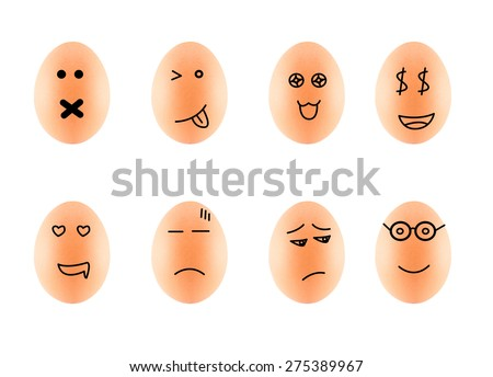 Funny Drawing Faces on Eggs in carton isolate on white with clipping path - stock photo