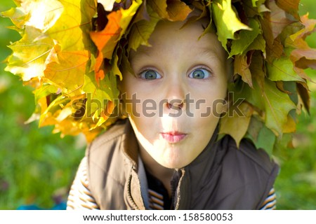 Funny emotional boy hamming for the camera - stock photo