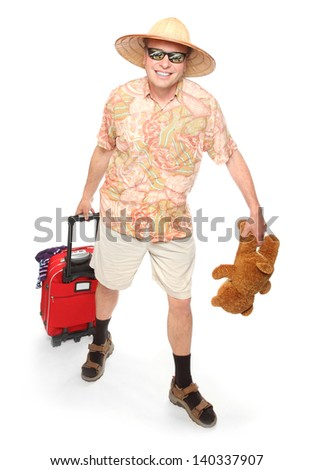 Funny european traveler with his suitcase and toys going to holidays. - stock photo