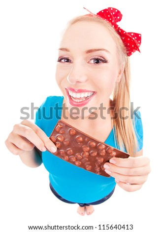 Funny excited girl with a chocolate isolated on white - stock photo