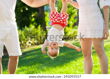 Funny family with baby girl in the park. Summertime - stock photo