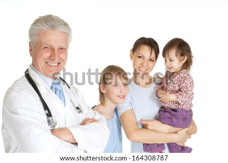 Funny family with children go to the doctor - stock photo