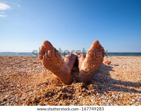 funny feet on warm summer  beach - stock photo