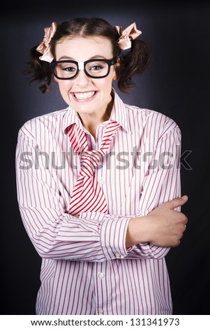 Funny Female Business Nerd Smiling With Big Geeky Grin On Dark Studio Background - stock photo