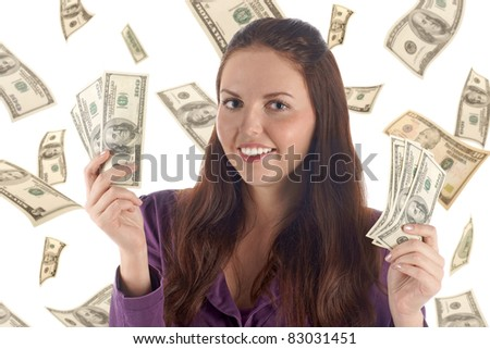 Funny female with two piles of banknotes on dollars background - stock photo