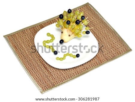 Funny figure hedgehog and caterpillars of fruit for children food, made by a child's hand - stock photo