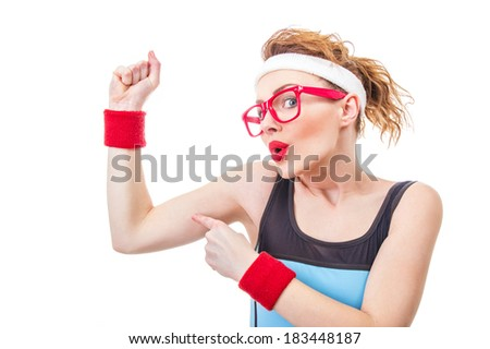 Funny fitness woman pointing on her biceps, isolate on white - stock photo