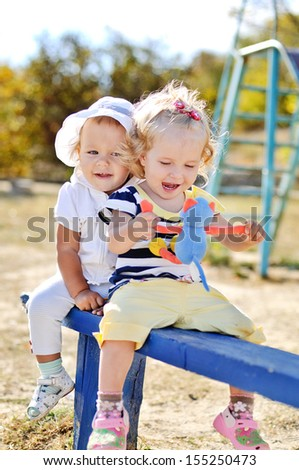 funny friends playing on the bench - stock photo
