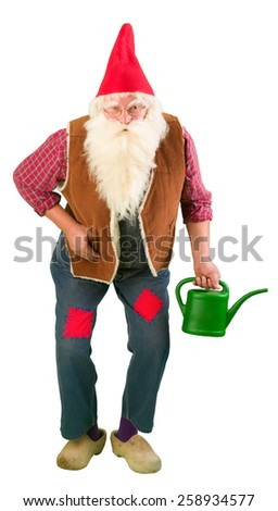 Funny garden gnome holding a miniature watering can - stock photo