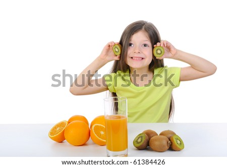 Funny girl holding slices of kiwi fruit in their hands. Isolated on white background - stock photo