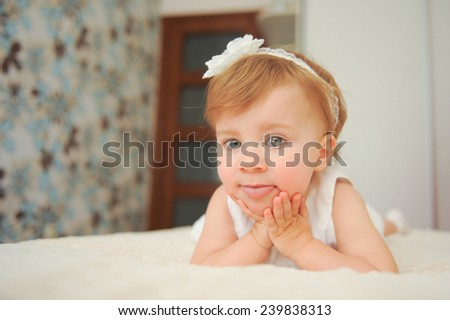 funny girl in bed showing tongue - stock photo