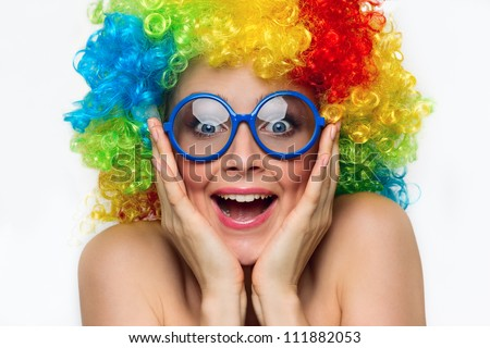 Funny girl in colored wig and blue glasses - stock photo