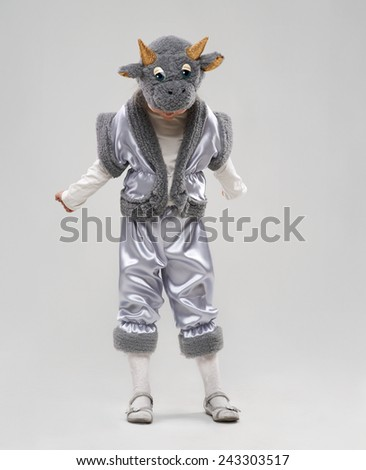 funny girl in cow costume looks down - stock photo