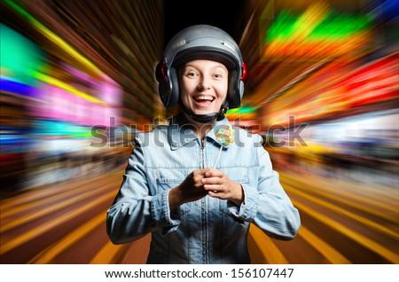 Funny girl in helmet moving on the street. - stock photo