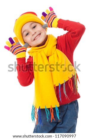 Funny girl in winter clothes, isolated on white - stock photo