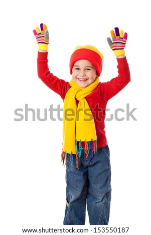 Funny girl in winter clothes with raised hands, isolated on white - stock photo