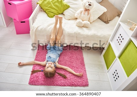 funny girl plays at home. girl having fun and resting. recreation and entertainment at home. - stock photo