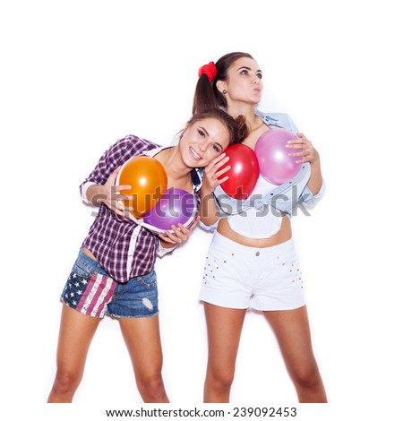 Funny girl put head on the fake chest of colored balloons her friend. White background not isolated - stock photo