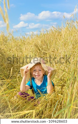 Funny girl sits among the tall rye. - stock photo