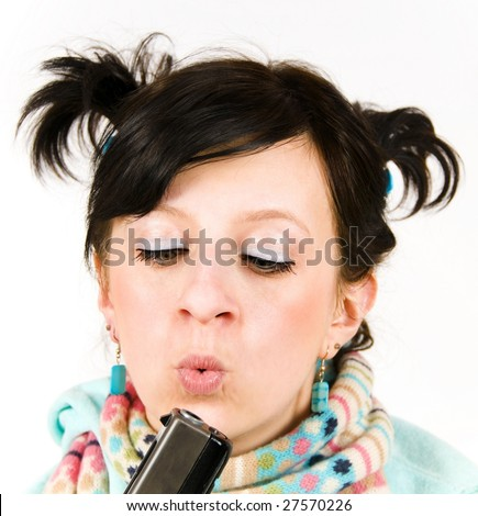 funny girl with a gun - stock photo