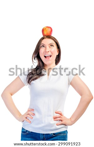 Funny girl with apple on her head on a white background - stock photo