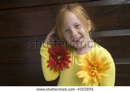 funny girl with freckles and flowers - stock photo