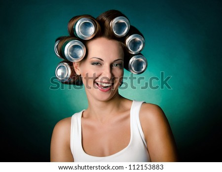 Funny girl with hair curlers on her head - stock photo