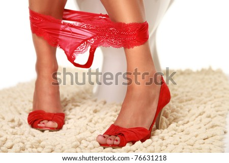 funny girl with red shoes in the toilet - stock photo