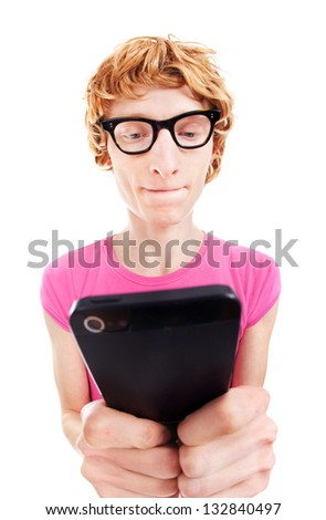 Funny guy concentrated while using smart phone - stock photo