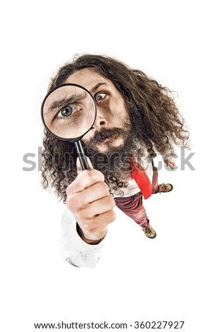 Funny guy holding a magnifying glass - stock photo