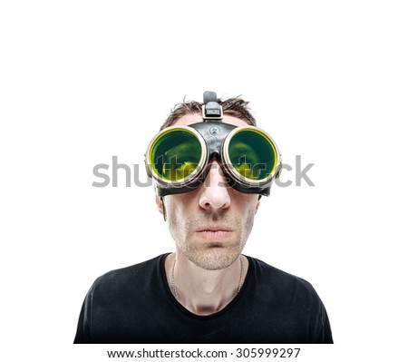 Funny guy in green vintage goggles looking up. Isolated on white. - stock photo