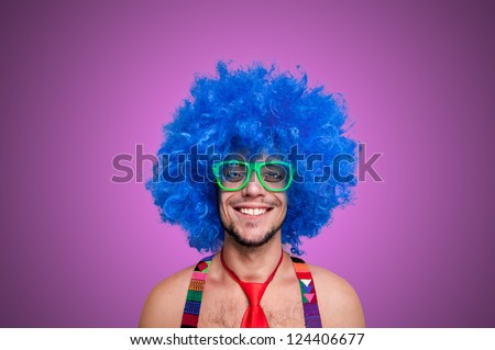 Funny guy naked with blue wig and red tie on pink background - stock photo