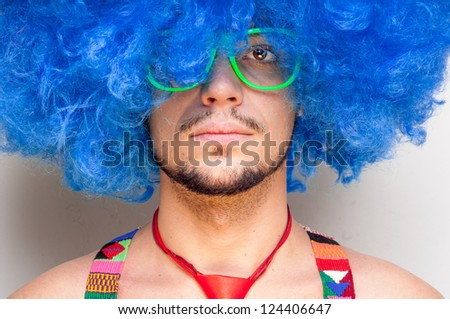 Funny guy naked with blue wig and red tie on white background - stock photo