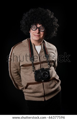 funny guy with a camera - stock photo