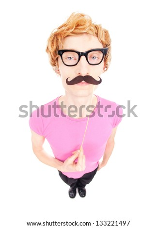 Funny guy with a fake mustache on a stick - stock photo