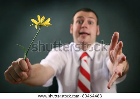 funny guy with yellow flower (focus on flower) - stock photo