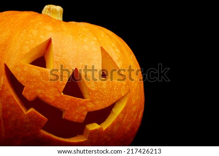 Funny halloween pumpkin isolated on black background - stock photo