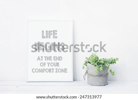 funny hand drawn poster LIFE BEGINS AT THE END OF YOUR COMFORT ZONE.  with succulent in diy concrete pot. Scandinavian style room interior - stock photo